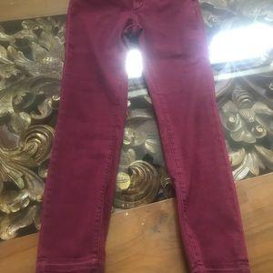 Dark red skinny jeans with raw hem